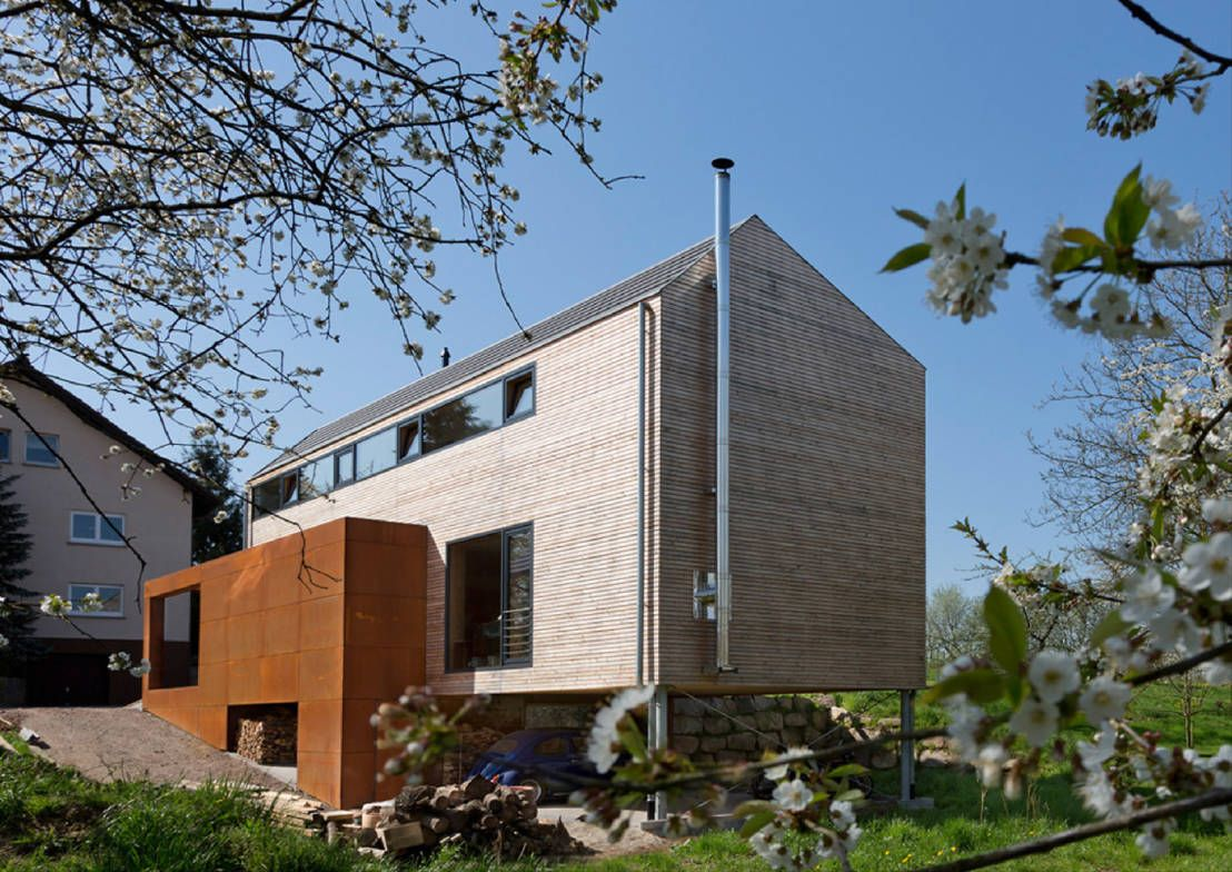 Cherry Blossom House (German Passivhaus) : Modern balcony, veranda & terrace by ÜberRaum Architects