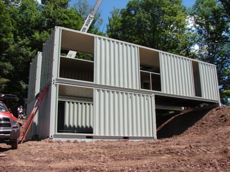 2 x 40 foot shipping container homes stacked on top of 2 smaller 20 foot shipping