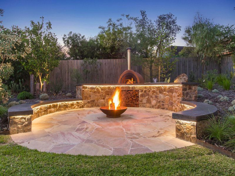 fire pit, pizza oven and seating backyard oasis Pinterest