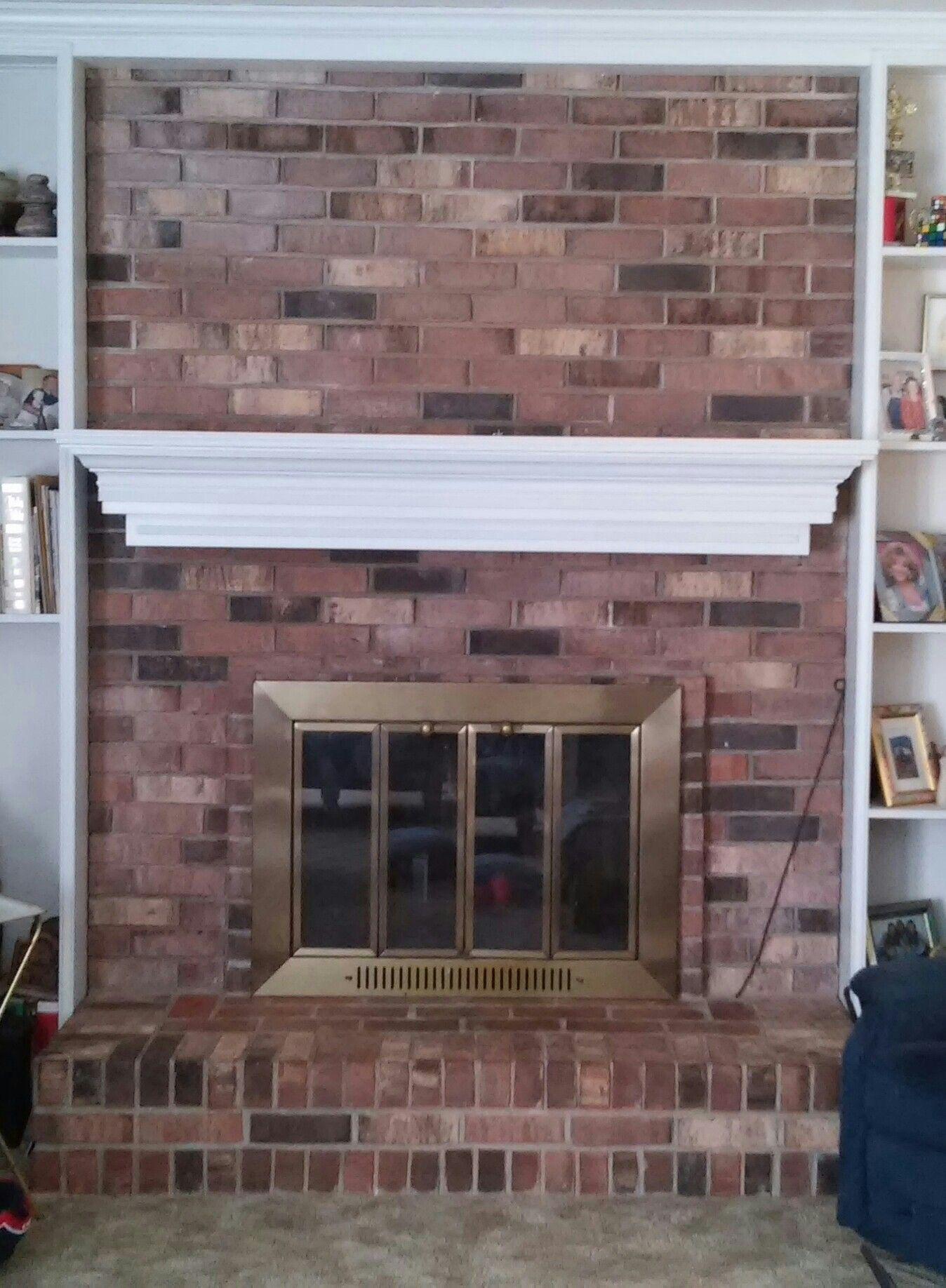 Before fireplace redowhitewash brick and paint screen