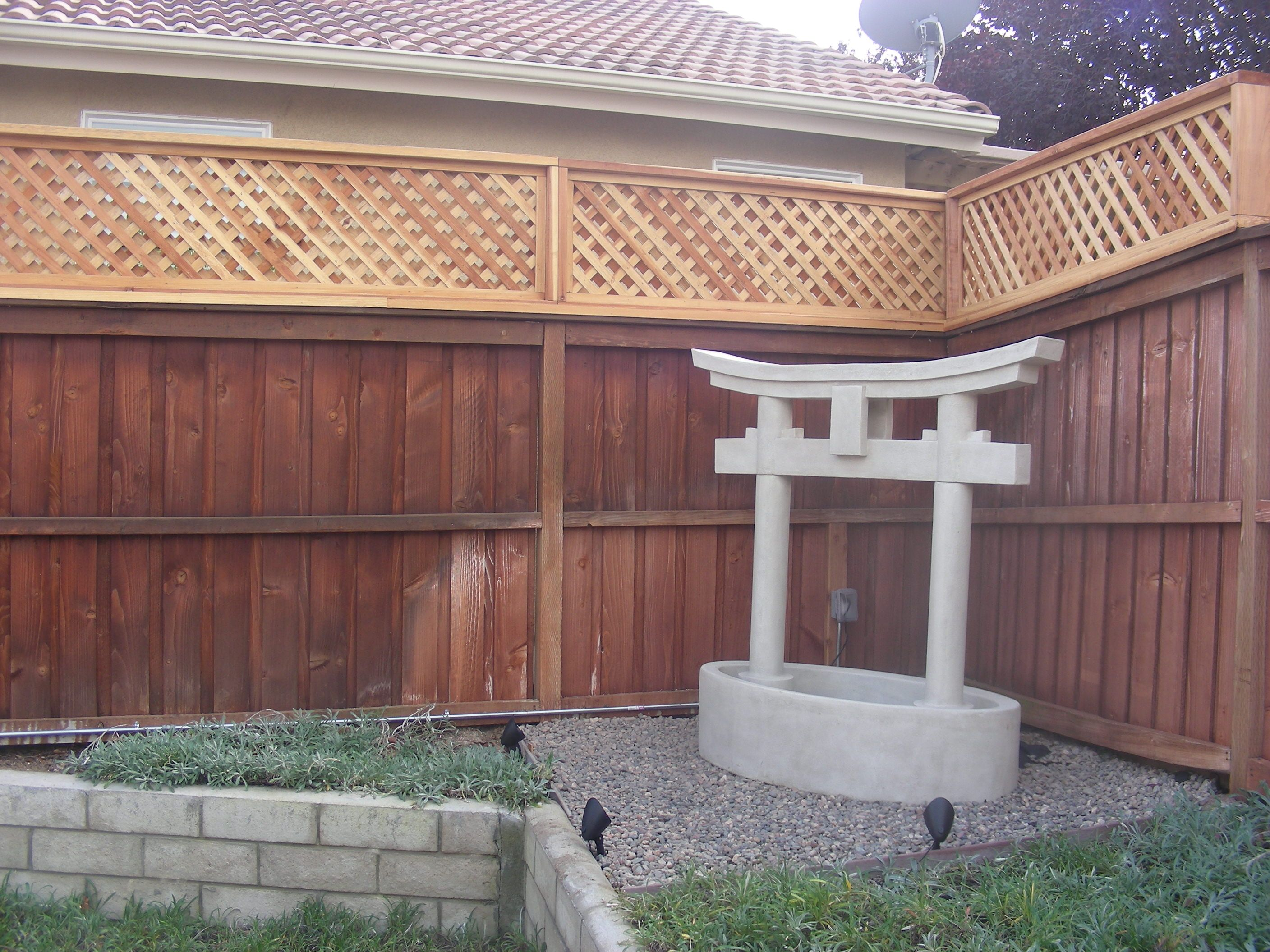 semi private lattice added to existing fence lattice on inexpensive way to build a wood privacy fence diy guide for 2020 id=16206