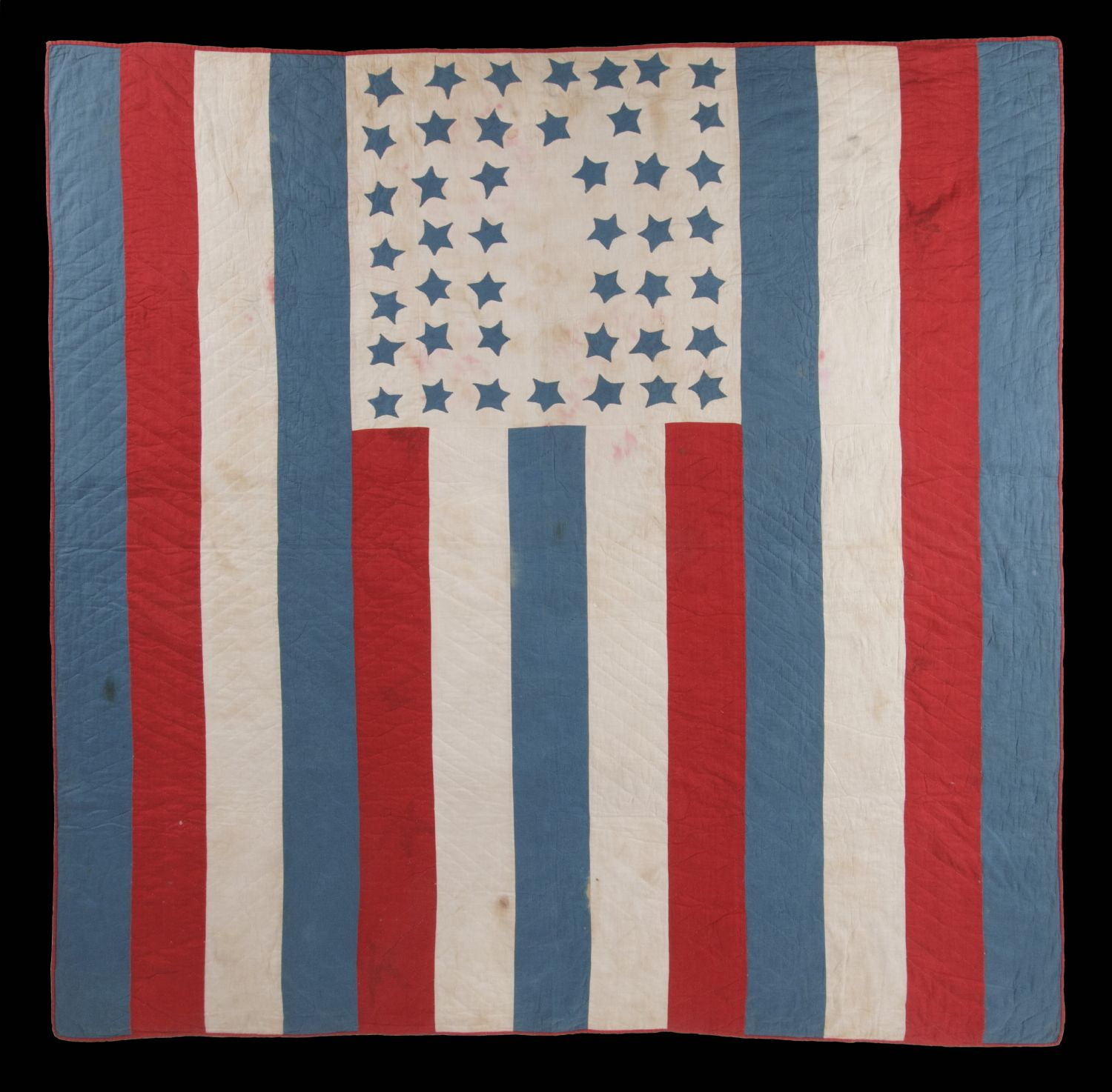 American Patriotic Flag Quilt With 44 Blue Stars Set Upon A White Ground In The Top Center Of 13 Red White And Blue Stripe Flag Quilt Quilts Patriotic Quilts