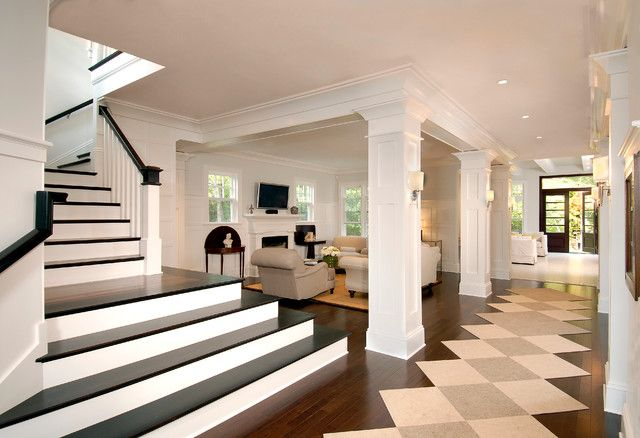 Traditional Staircase With Black Footings And Long White