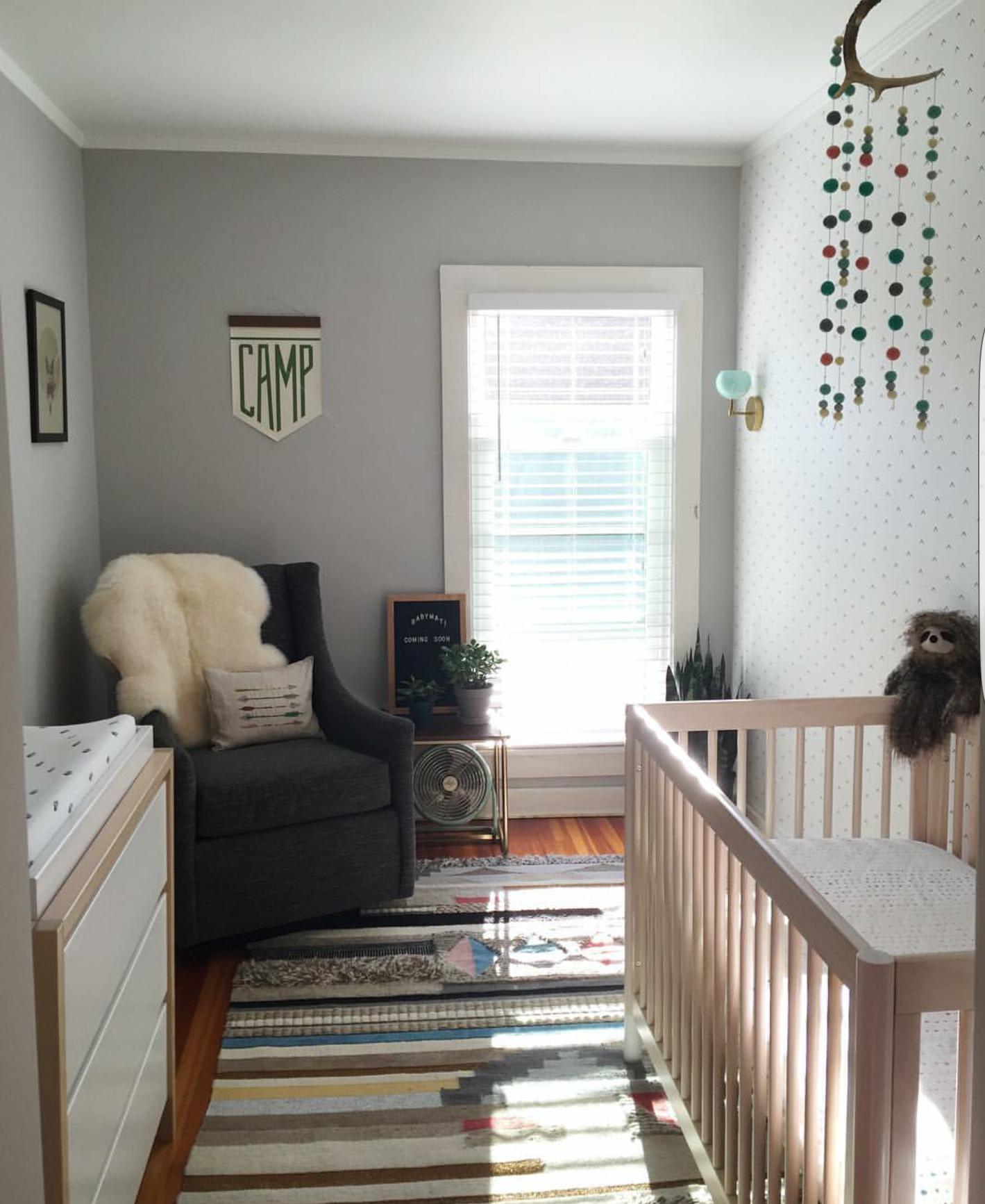 Baby boy nursery design with grey walls, neutral rug ...