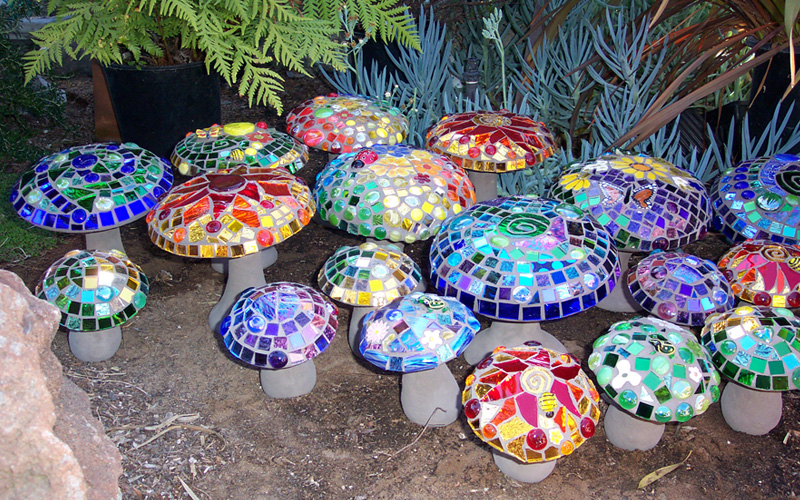 20 Mosaic Garden Decoration Ideas That Will Blow Your Mind is part of Mosaic garden art, Mosaic garden, Garden art, Mosaic crafts, Mosaic diy, Garden mushrooms - Gardeners spend a lot of time creating visual impacts with plant life  Flowers in the spring and summer, and colorful foliage in the fall and winter, plus other dynamic foliage and shapes year round can create wonderful design elements in the garden  But plants aren't the only things that can please the eye  One way to tie different elements of the garden together, fill in empty space, and define different garden areas is creative use of stonework, particularly mosaic patterns  Stone doesn't lose its color with the changing seasons, and so it can offer your garden different focal points as