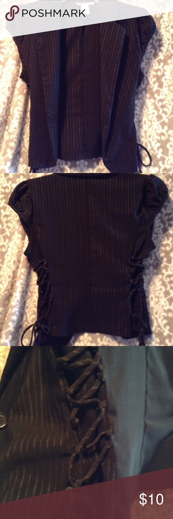 Charlotte Russe blouse Charlotte Russe size medium dressy business attire. Short sleeve, black, string design. Great condition. Tops