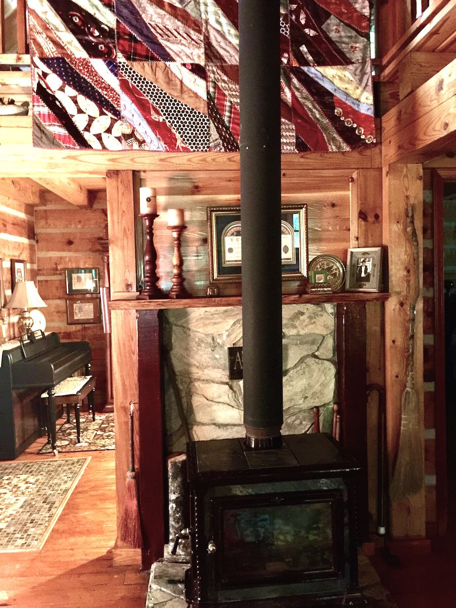 Southland Log Home Hearthstone Woodstove. Log Home now
