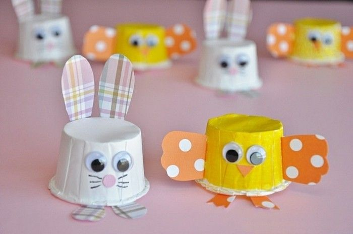 easy kids crafts, bunny and chick decorations, made from small paper cups in white and yellow, decorated with colorful paper and stick-on eyes