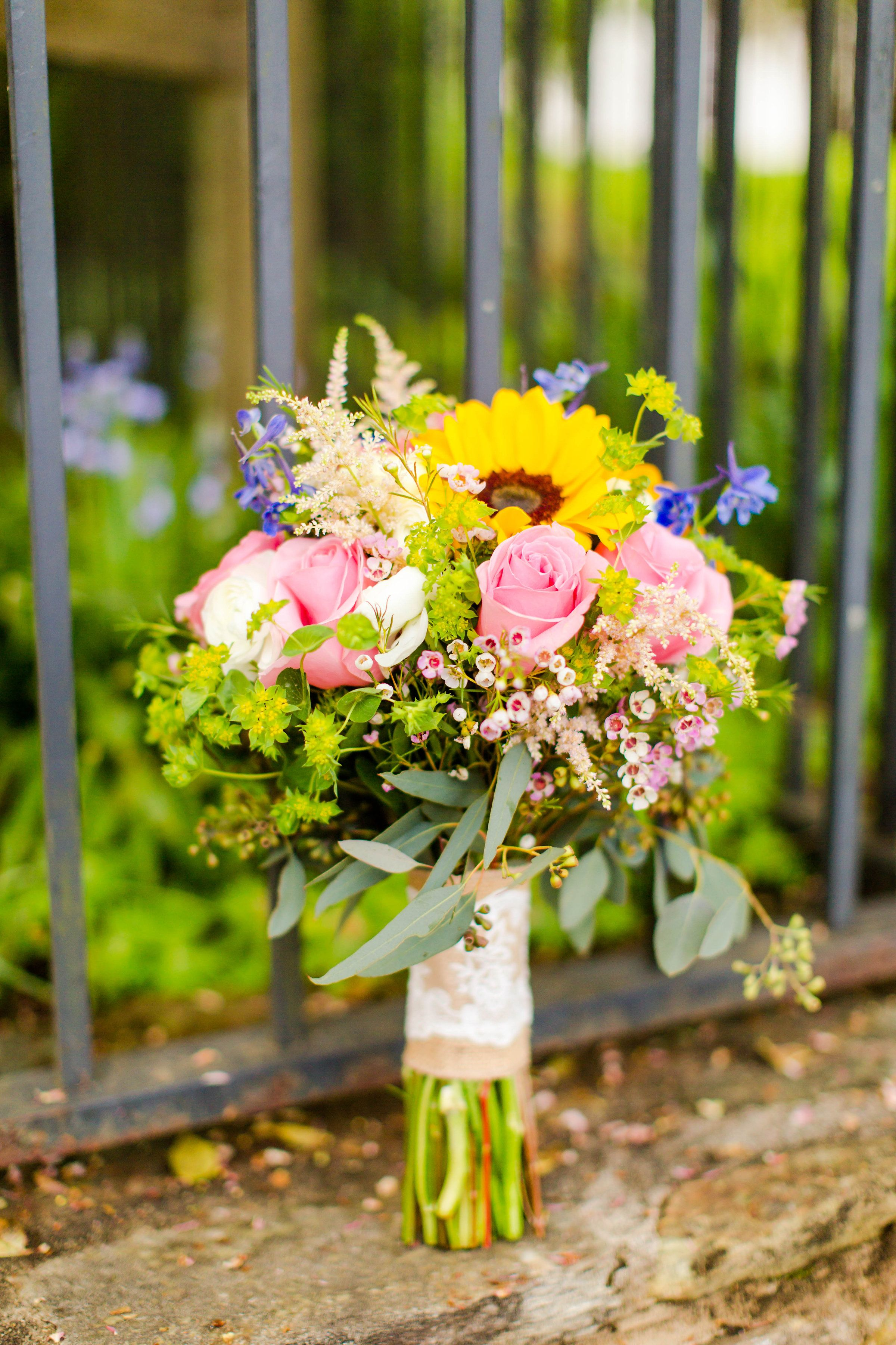 Wedding bouquets of sunflowers  Brightly colored flowers and sunflowers are a gorgeous pairing for a