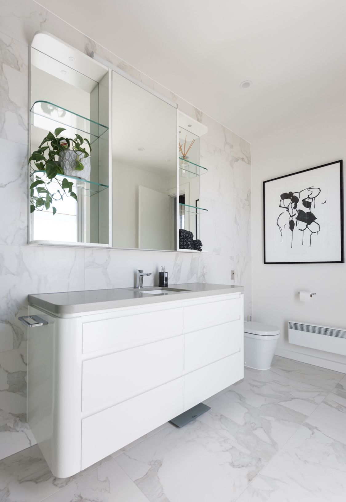Love the marble tiles on the wall. A white bathroom is