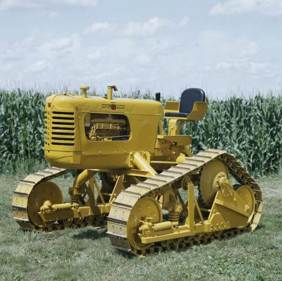 A selection of different makes of crawler tractors through history
