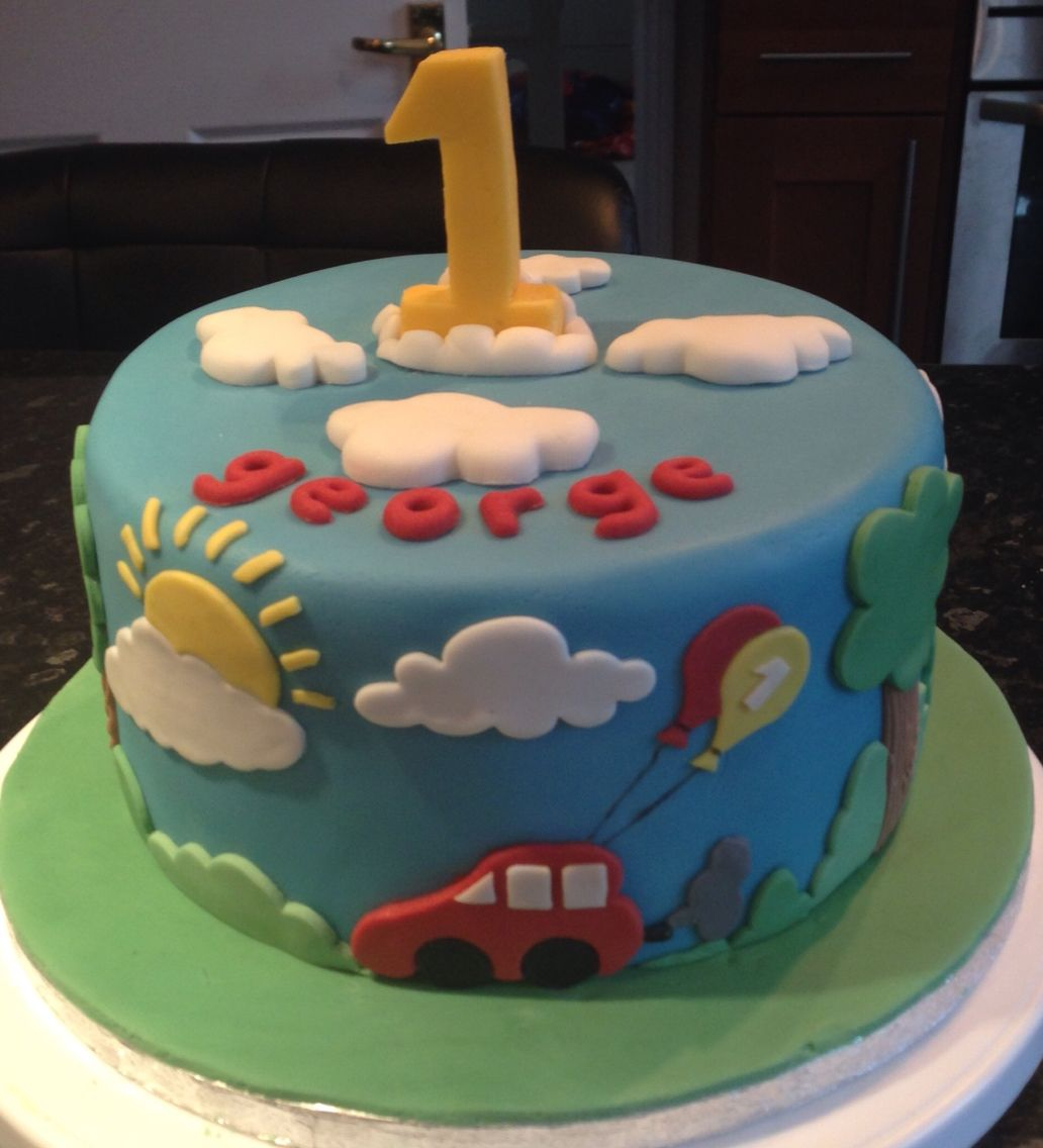 boys first birthday cake with car bade using mostly cloud cutters