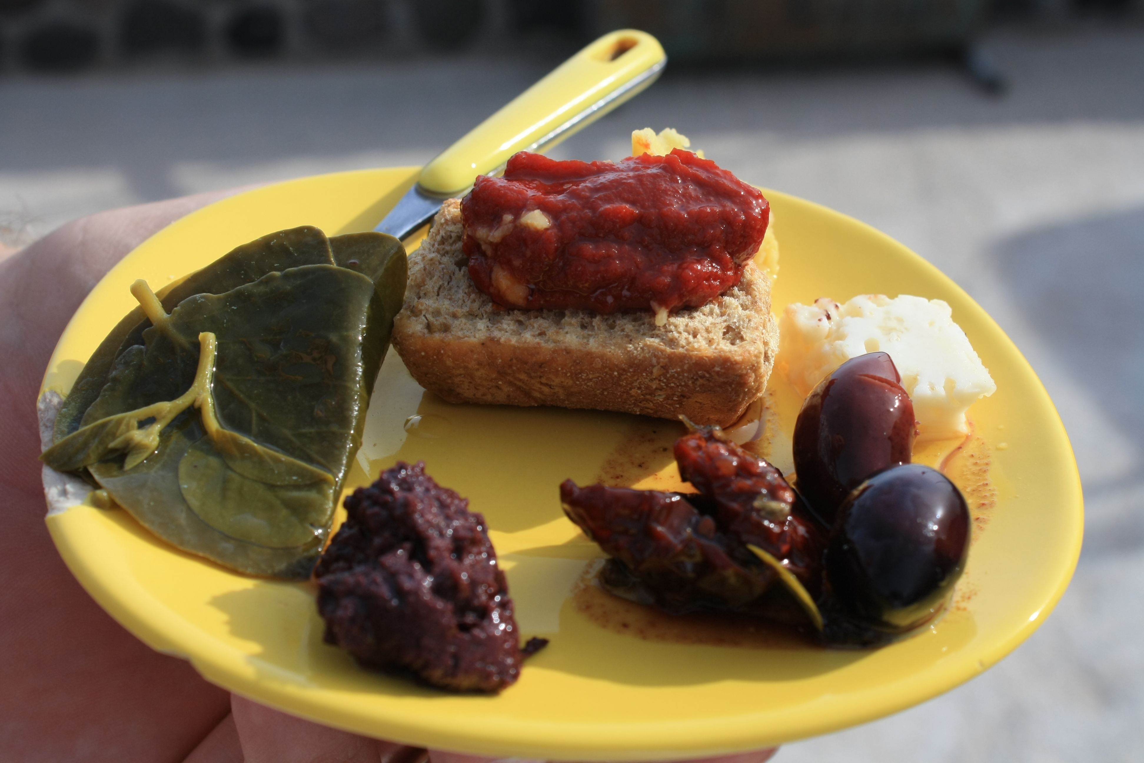 On the south side of Santorini along the roadside and Greek vineyards, you will find a little road-side shop with a Santorini native selling her homemade canned goods: sun dried tomatoes, pickled caper leaves, tomato spread and  olives. She was even on Giada!