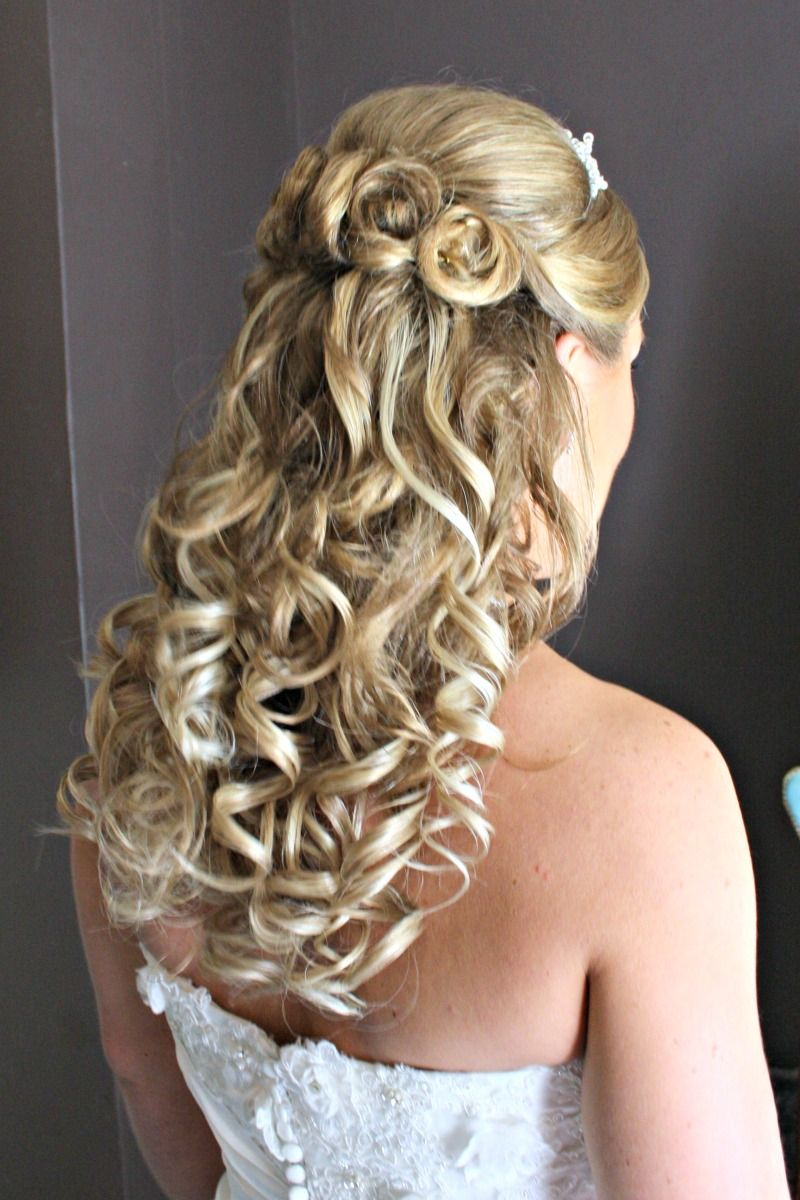 wedding hairstyle with the hair half up and half down with the hair