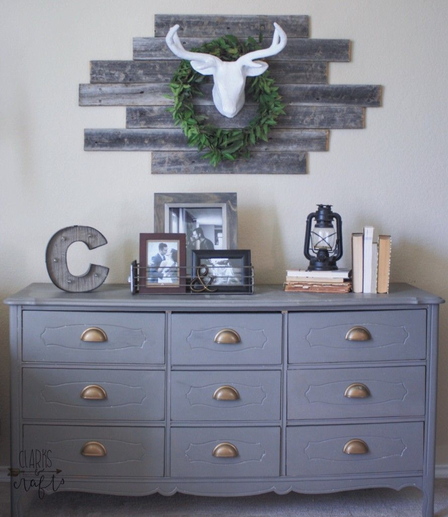 I love the rustic wall piece and the frames on the gray