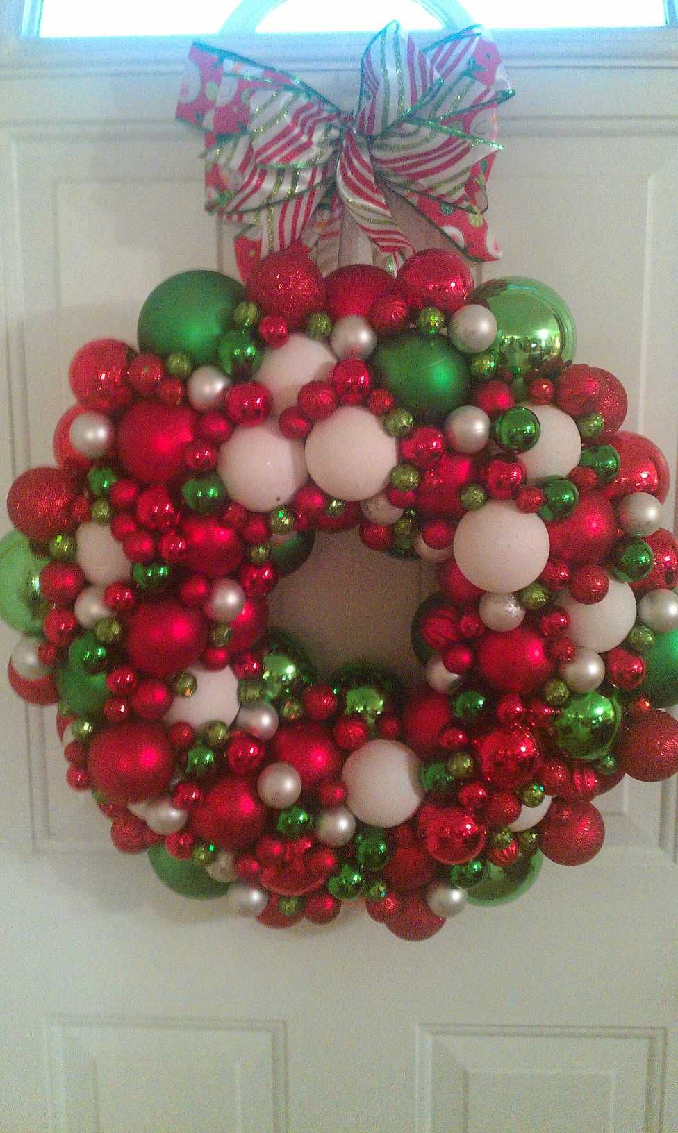 I saw this on pinterest almost a year ago and decided to make one. I used a styro-foam wreath & non- breakable Christmas ornaments of various sizes. I lost count. I started with the largest size, spaced them out  glued them with the top down. (Take off the cap) Then I just continued with the next largest size and so on, filling in the gaps as I went. I attached a bow (wired ribbon) with long streamers which I stapled to the back of the wreath. I loved the way it turned out!