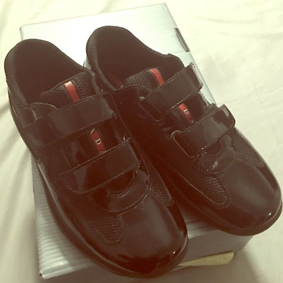 Amazing condition Authentic Prada shoes Beautiful patent leather Prada sneakers in amazing condition worn a few times comes with og box!!  You won't find another pair in this condition and size! Fits a size 6 to 7 Prada Shoes