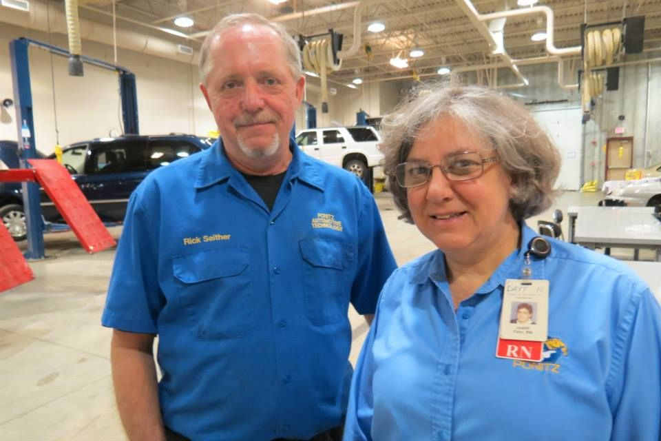 Automotive Technology Supervisor Rick Seither With Nurse Judy Fehr Rick S Automotive Students Washed Cars To Raise M Mens Tops How To Raise Money Chef Jackets