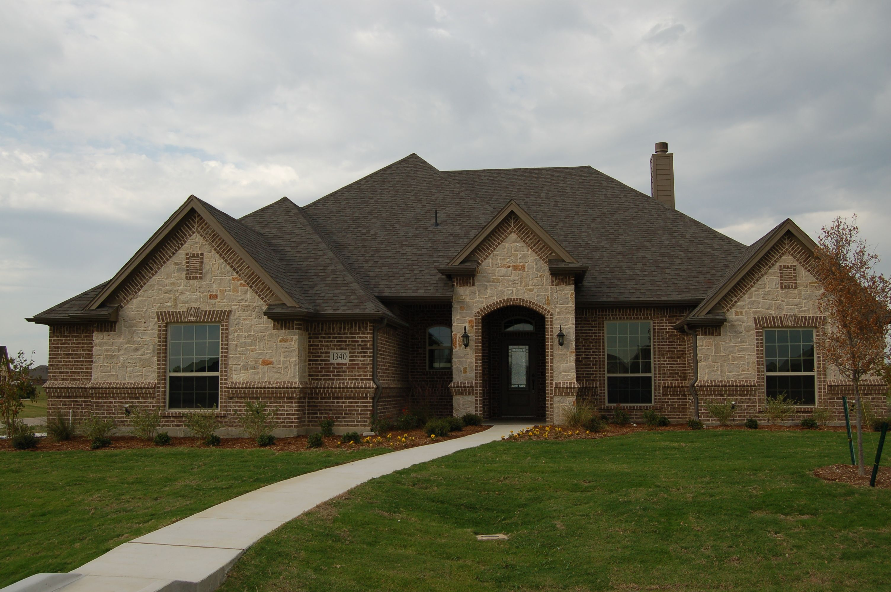 Brick Front Elevation Designs : Front elevation brick and stone mcbeehomes
