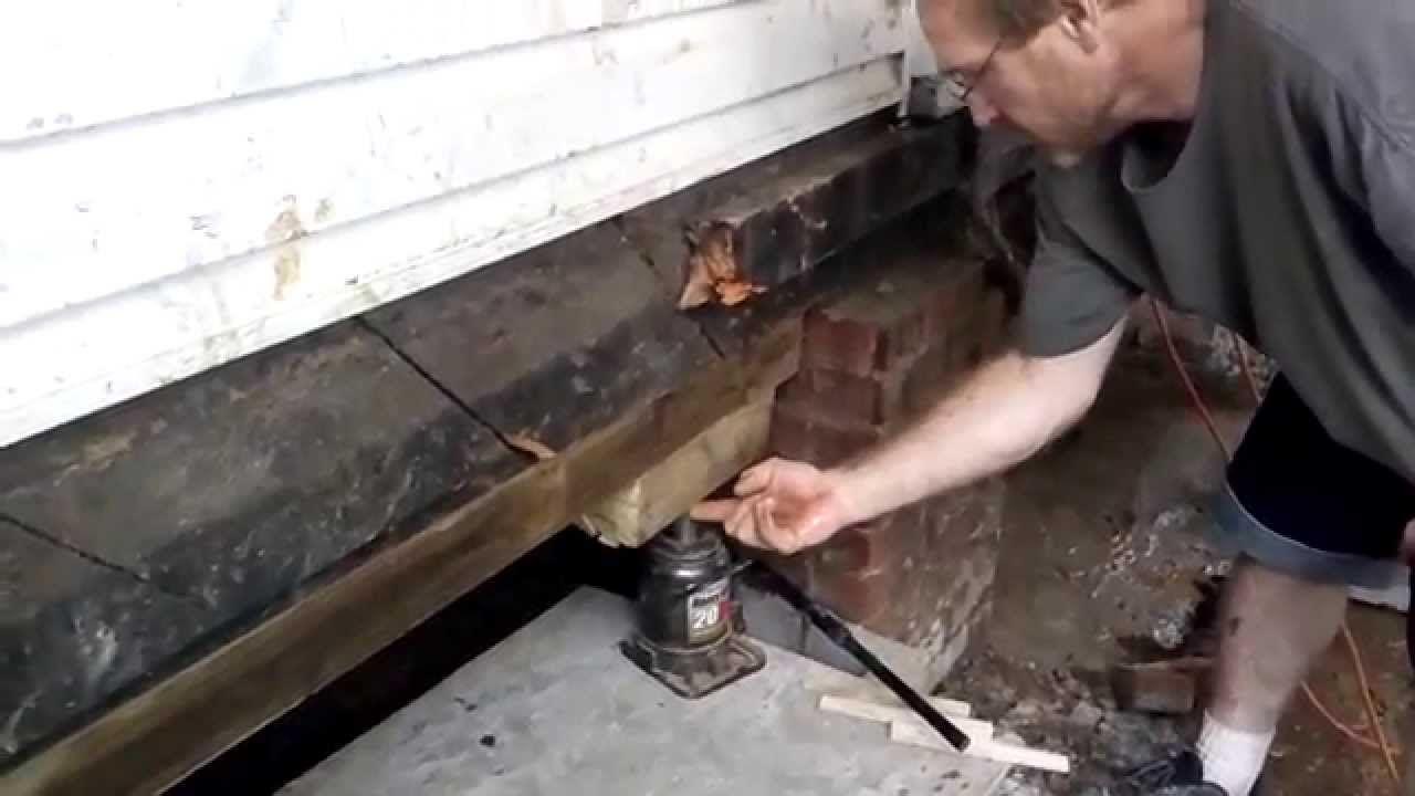 Leveling a House fix sinking Foundation Jacking Level