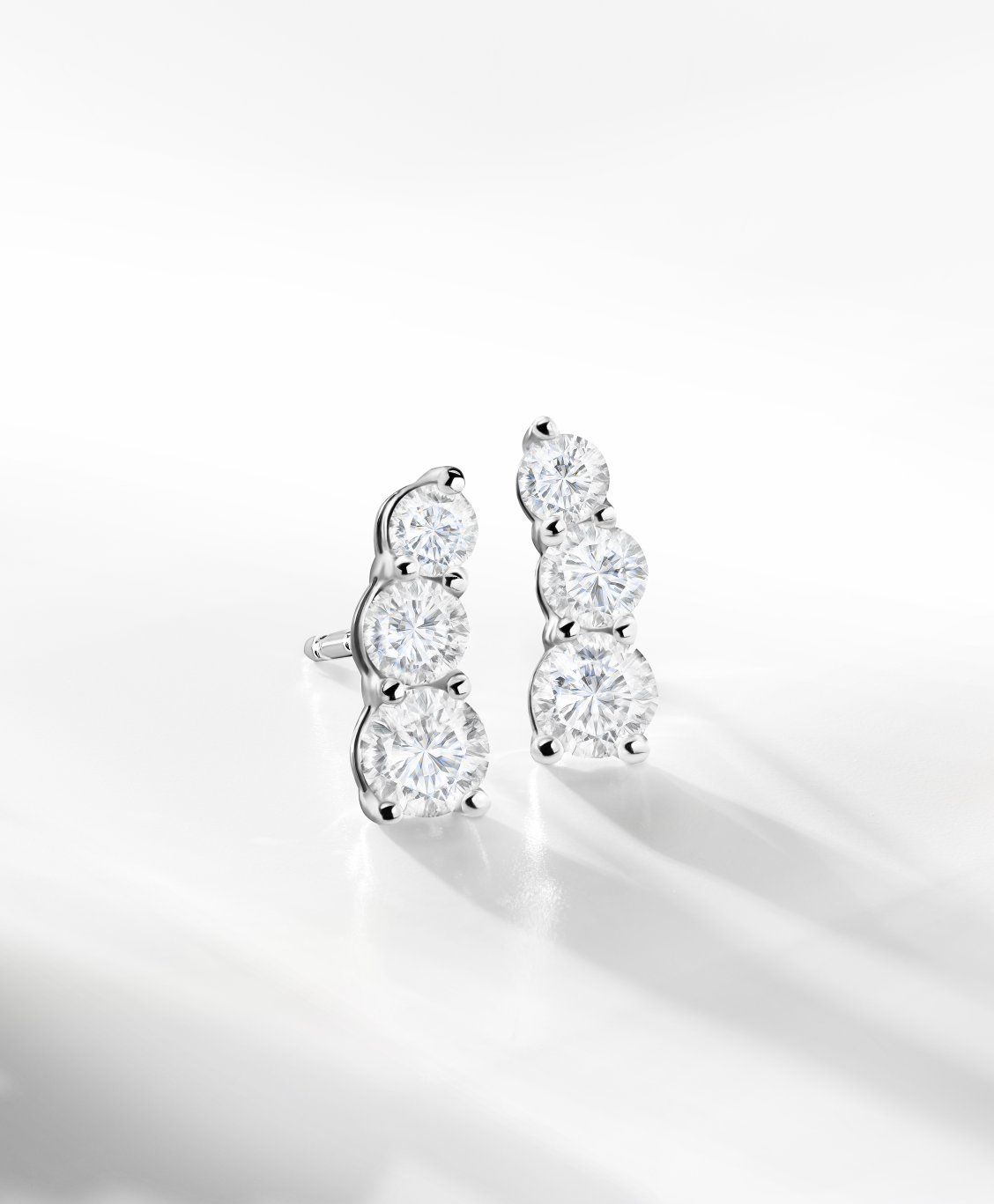 5c87492ff These three-stone diamond earrings are a gift she'll truly treasure forever.