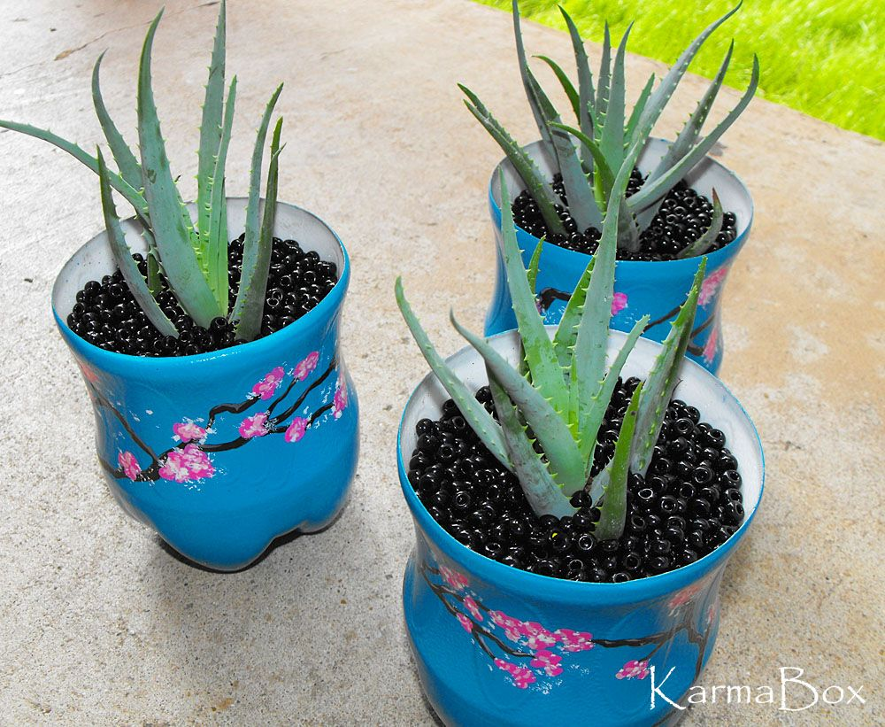 Pretty painted planters cut 2 liter soda bottles use a for Pretty plastic bottles