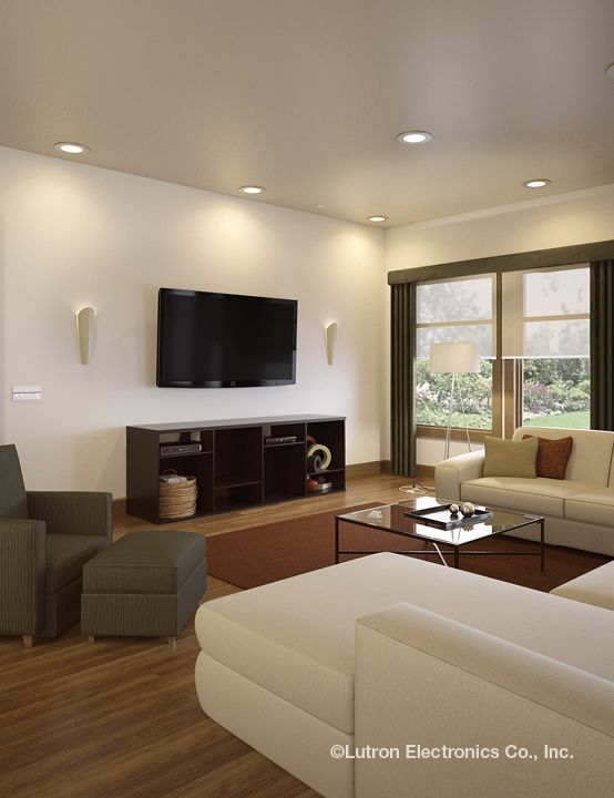 Neutral Colors Simple Fabrics And Recessed Lighting In The Family Room Keep Focus On Screen Tv