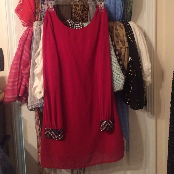 Red Dress. beaded cuffs Red Dress. Perfect for date nights. It is Short. Worn once Dresses Midi