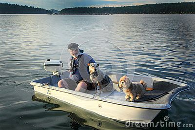 Boater with dogs on small boat