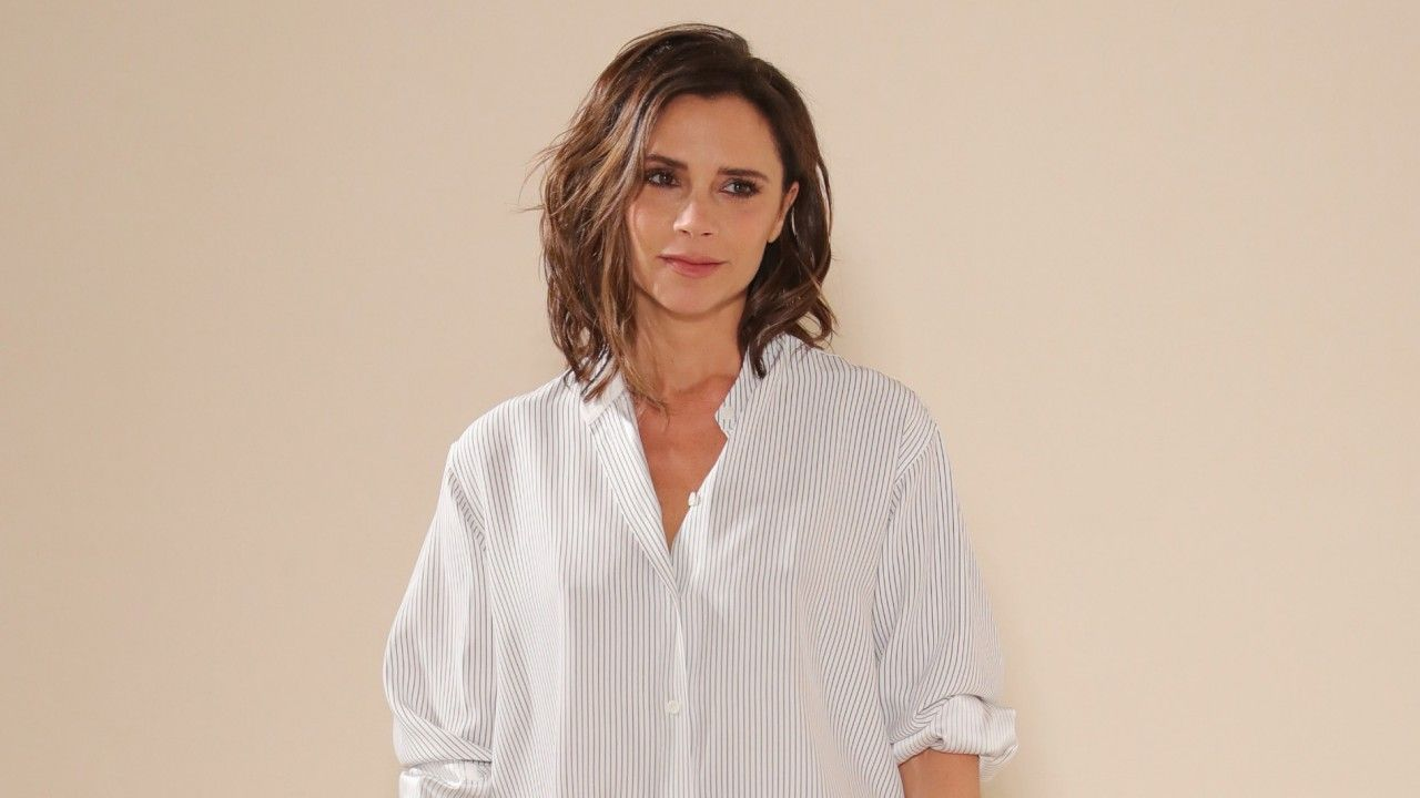 See How Victoria Beckham Styles a Button-Down Shirt: Victoria Beckham was always a bit of a uniform dresser, but while her days of black Posh Spice minidresses are far (far) behind her, the designer's found something else to wear just as frequently: button-downs. -- white button-down. | Coveteur.com
