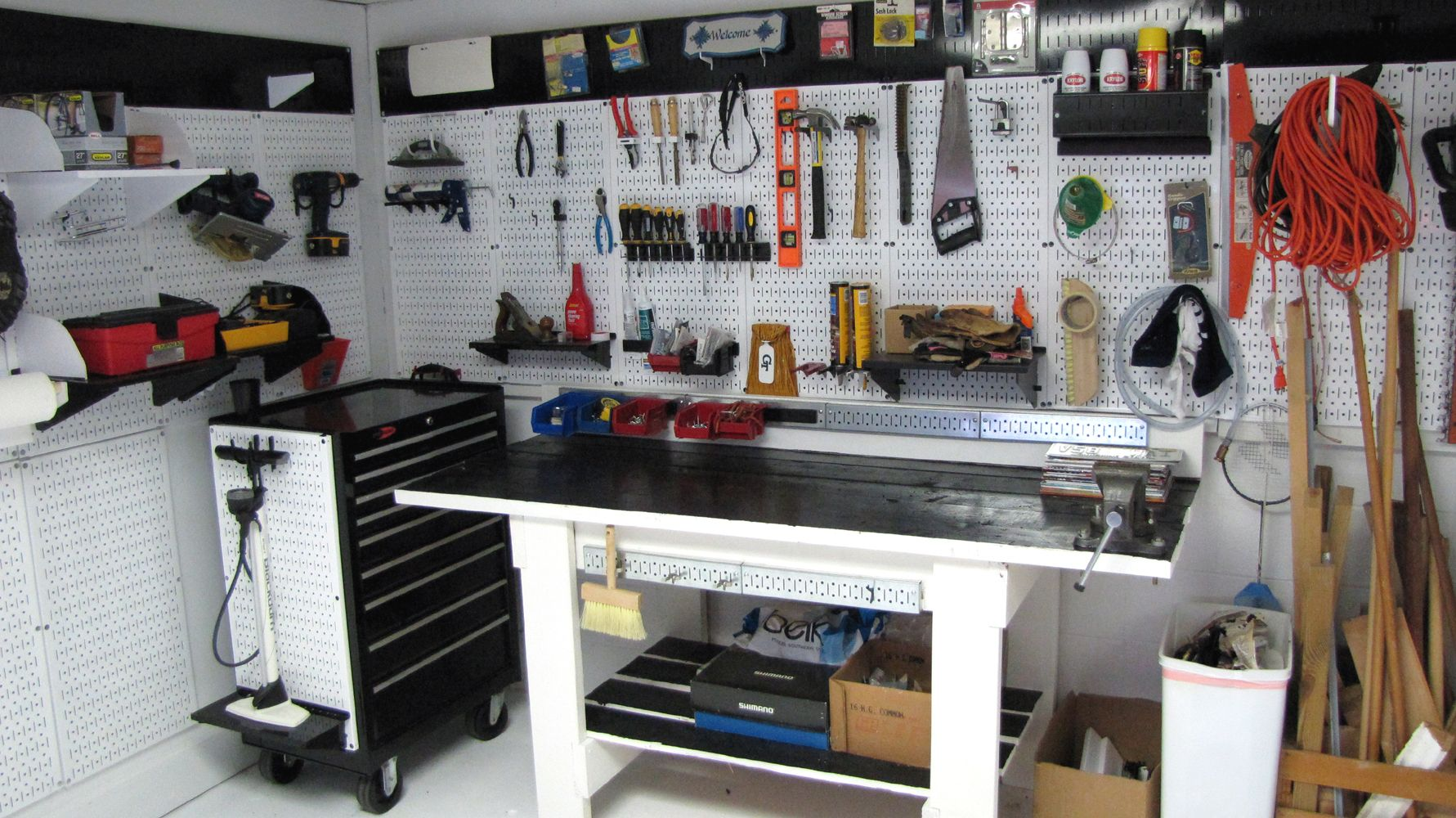 A wall control metal pegboard work area great for bike and diy wall control garage pegboard tool organizers a gallery of garage storage and organization pegboard ideas publicscrutiny Images