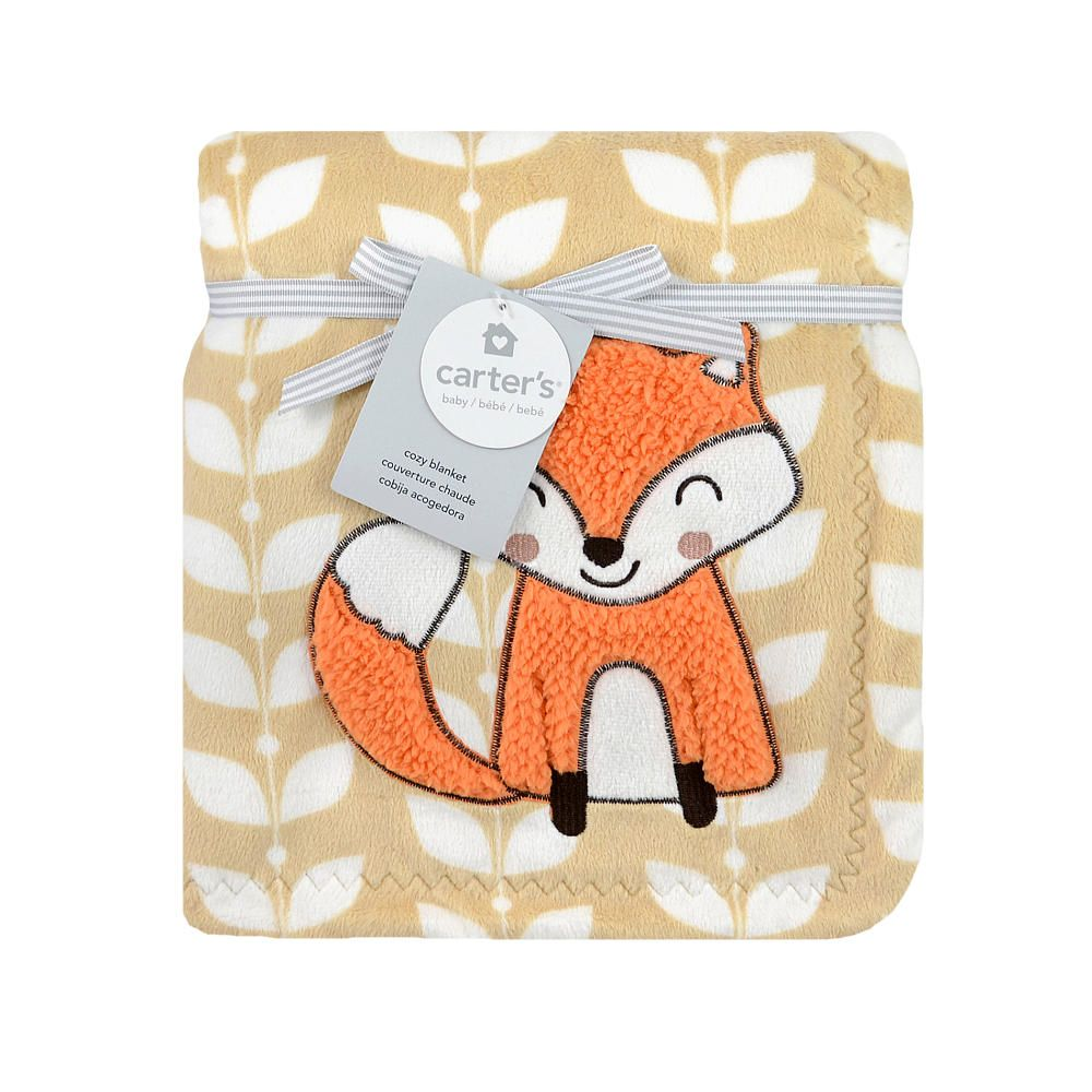 """Your little one deserves something soft and warm; this cozy velour blanket from Carter's is just the thing. The solid beige background features printed leaves with an adorable orange fox applique. This blanket is crafted using silky smooth 100% polyester, measures 30"""" x 40"""", and is machine washable. Tumble dry low."""