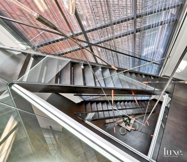 Contemporary Glass Atrium with Triangular-Shaped Skylight ...