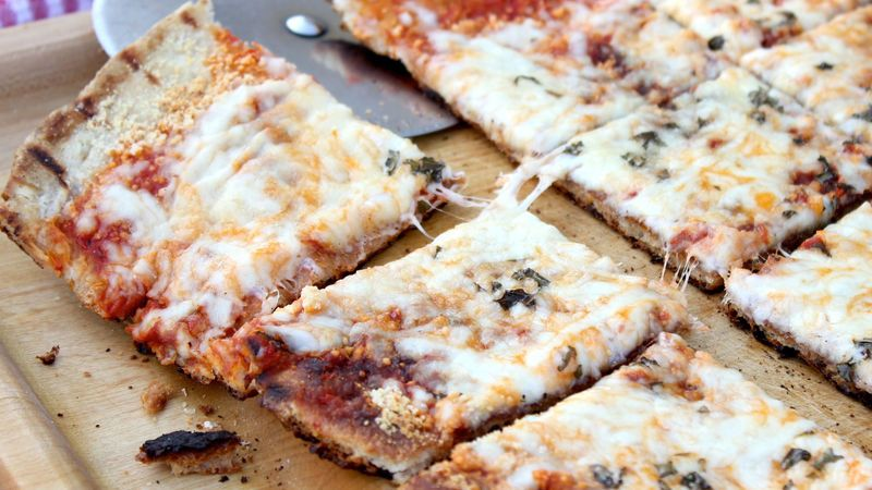 This pizza has reached the cheesy extreme, with extra gooeyness from the grill.