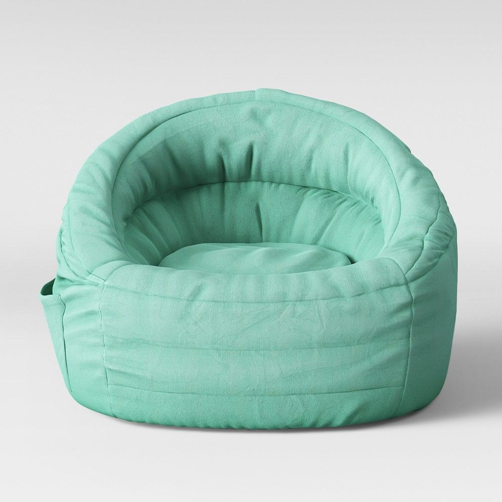 Cocoon Bean Bag Chair with Pocket Aqua  Pillowfort™ is part of Bean bag chair - Your kids will love sitting on the Cocoon Bean Bag Chair With Pocket from Pillowfort™  Filled full for comfort, this bean bag for kids has a structured build that provides support as they sit  Featuring a side pocket that can store their drawing books, toys or other knickknacks, this bean bag brings a functional update to your kid's room