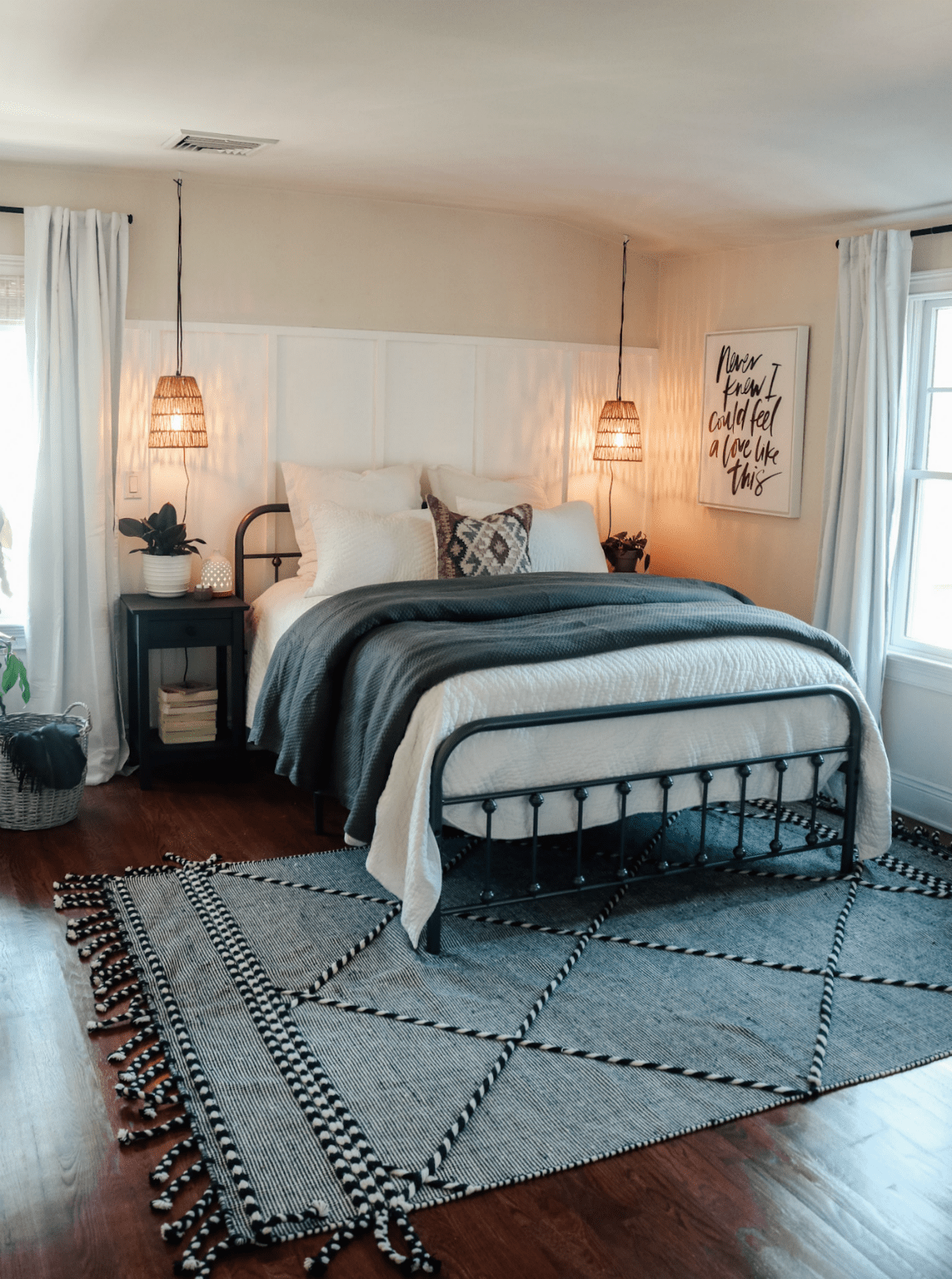 Simple and Affordable Master Bedroom Makeover | Nesting With Grace | Neutral gray, black and white bedroom update with woven basket lighting and board and batten wall. #bedroom #masterbedroom