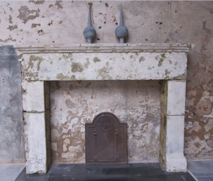 Distressed 18C French stone fireplace for sale on SalvoWEB #antiquefireplace