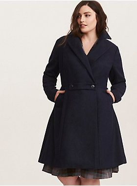 0ae33d92996 The heavy navy swing coat has a fit and flare silhouette that streamlines  your figure as it keeps you warm.Notched collarButton closureSide pockets