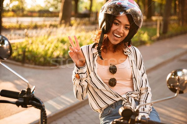 Happy african woman in moto helmet sitting on modern motorbike stock photo © dean drobot (deandrobot) (#8606590) | Stockfresh