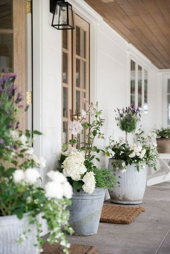 How to Plant Stunning Summer Flower Pot Ideas is part of Porch flowers, Flower pots, Summer flowers, Hydrangea garden, Wooden french doors, Beautiful patios - Follow this simple formula to create beautiful summer flower pots! Plus, lots of ideas for sprucing up your porch for summer!