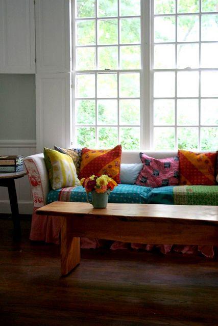 sari quilts for sofa cover. genius!