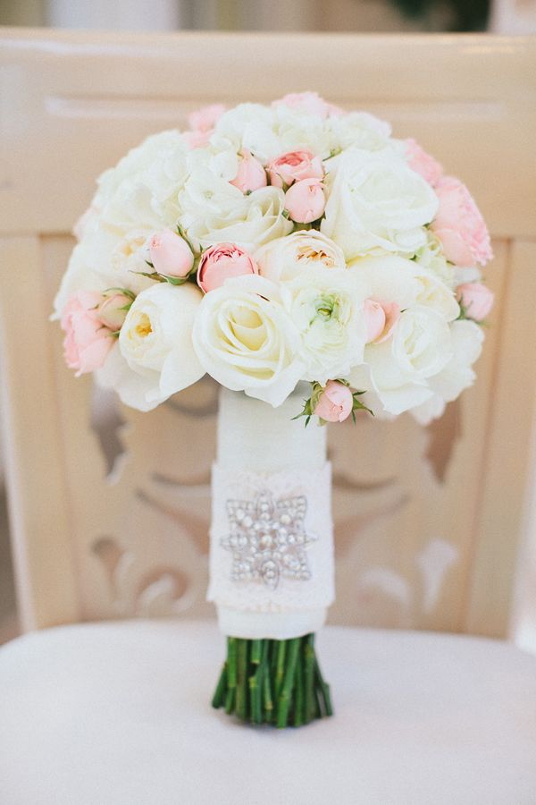 cream and light coral bouquet design, adding in dusty miller and white feathers