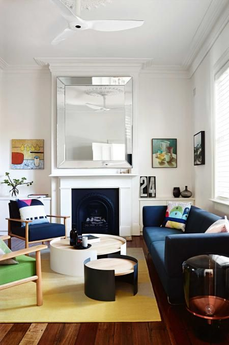 White Walls Wood Floor Blue Sofa Yellow Rug White Ceiling Fan Giant Mirror Above Fireplace Livin Living Room Modern Italian Living Room Living Room White