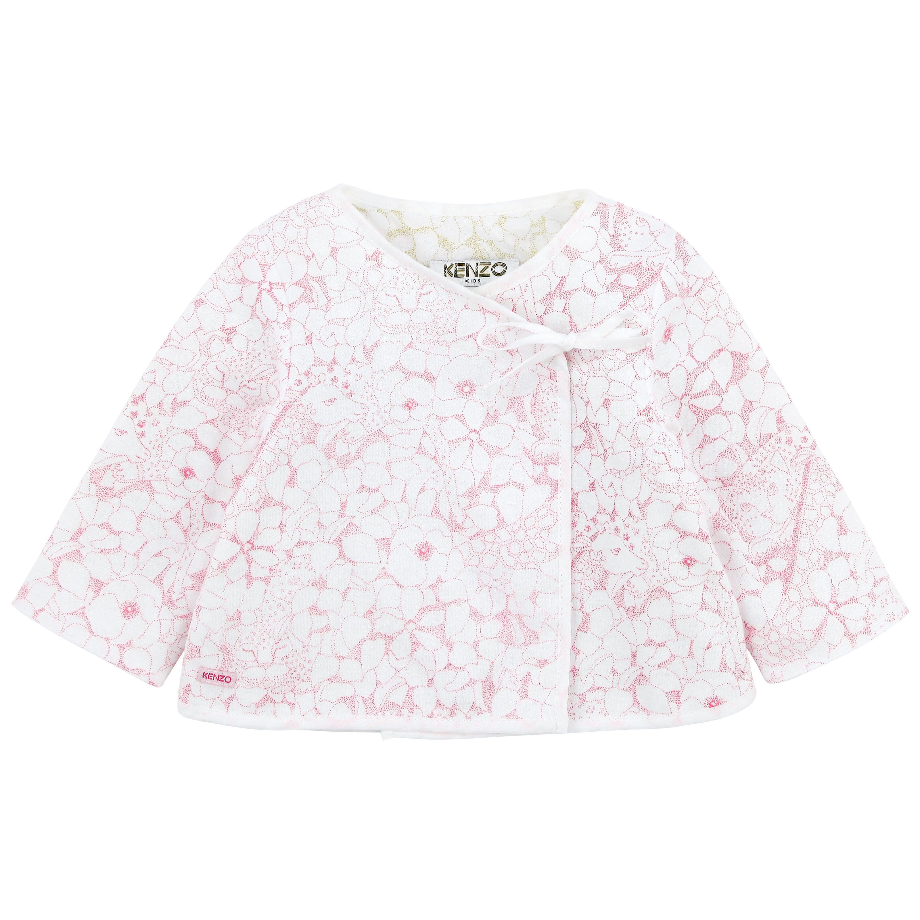 Reversible cardigan made of cotton jersey and printed voile. Long sleeves. Ribbons to tie on the front. - 52,00 €