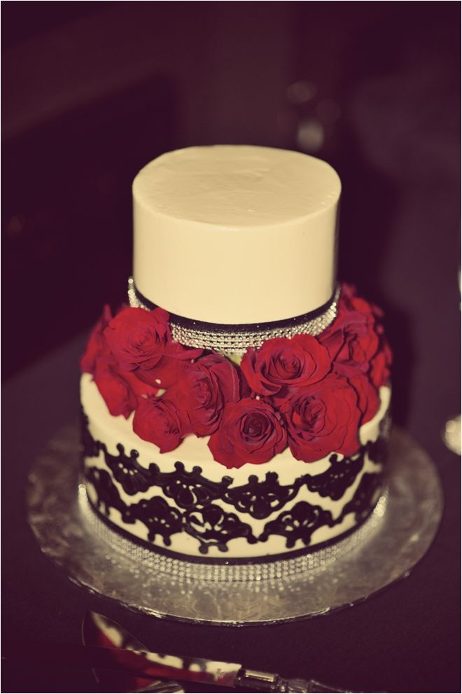 Vintage red, black, and ivory wedding cake from Rustika Cafe & Bakery ~ Photography: DC Stanley Photography