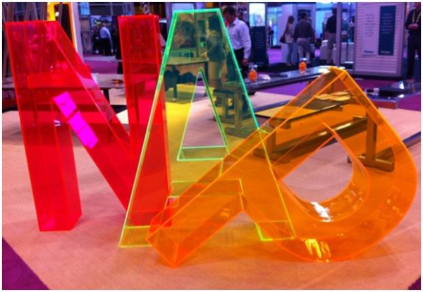 Transparent Neon Shades Of Yellow Pink Orange And Green Added Vivid Flashes Of Color To Retail Displays With Images Signage Design Retail Display Neon Design