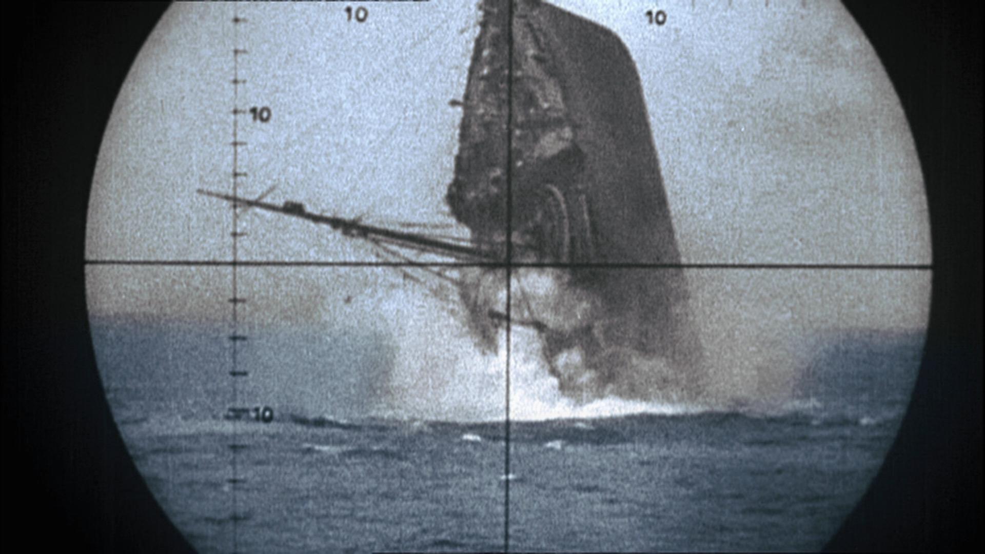 u-boats ~ allied vessel sinking, seen through periscope of a
