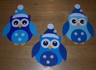 Photo of 3 small winter owls window picture made of cardboard (blue):