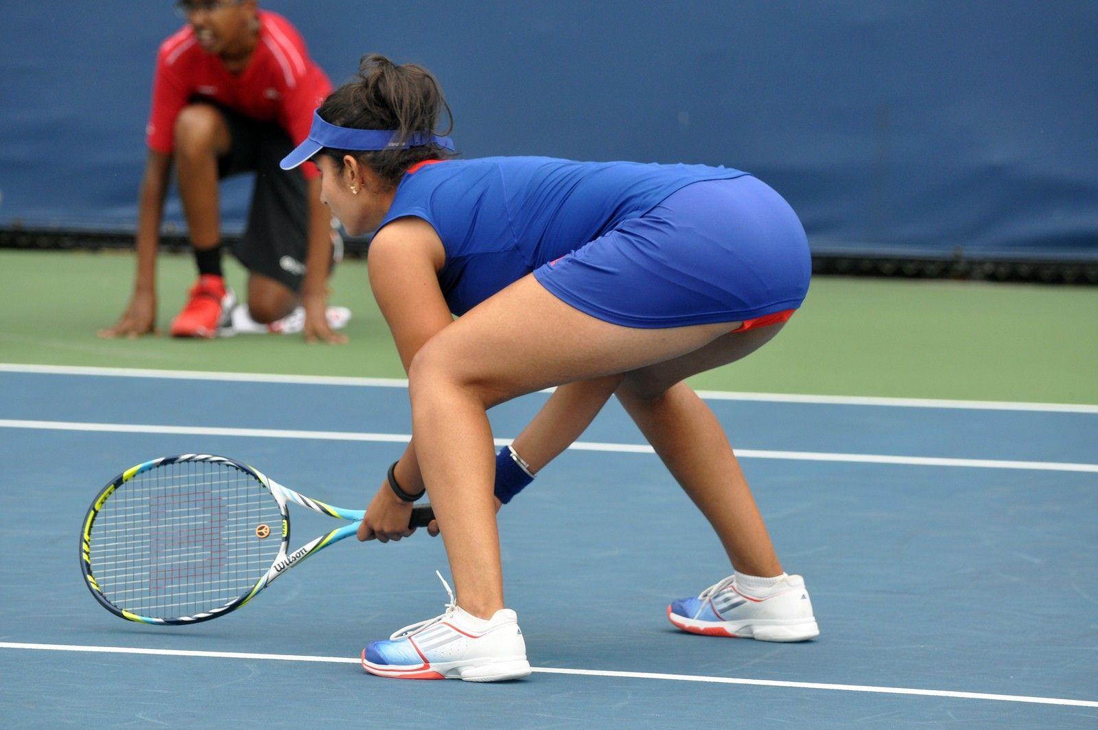 Indian Tennis Player Sania Mirza Hot Photos In White T