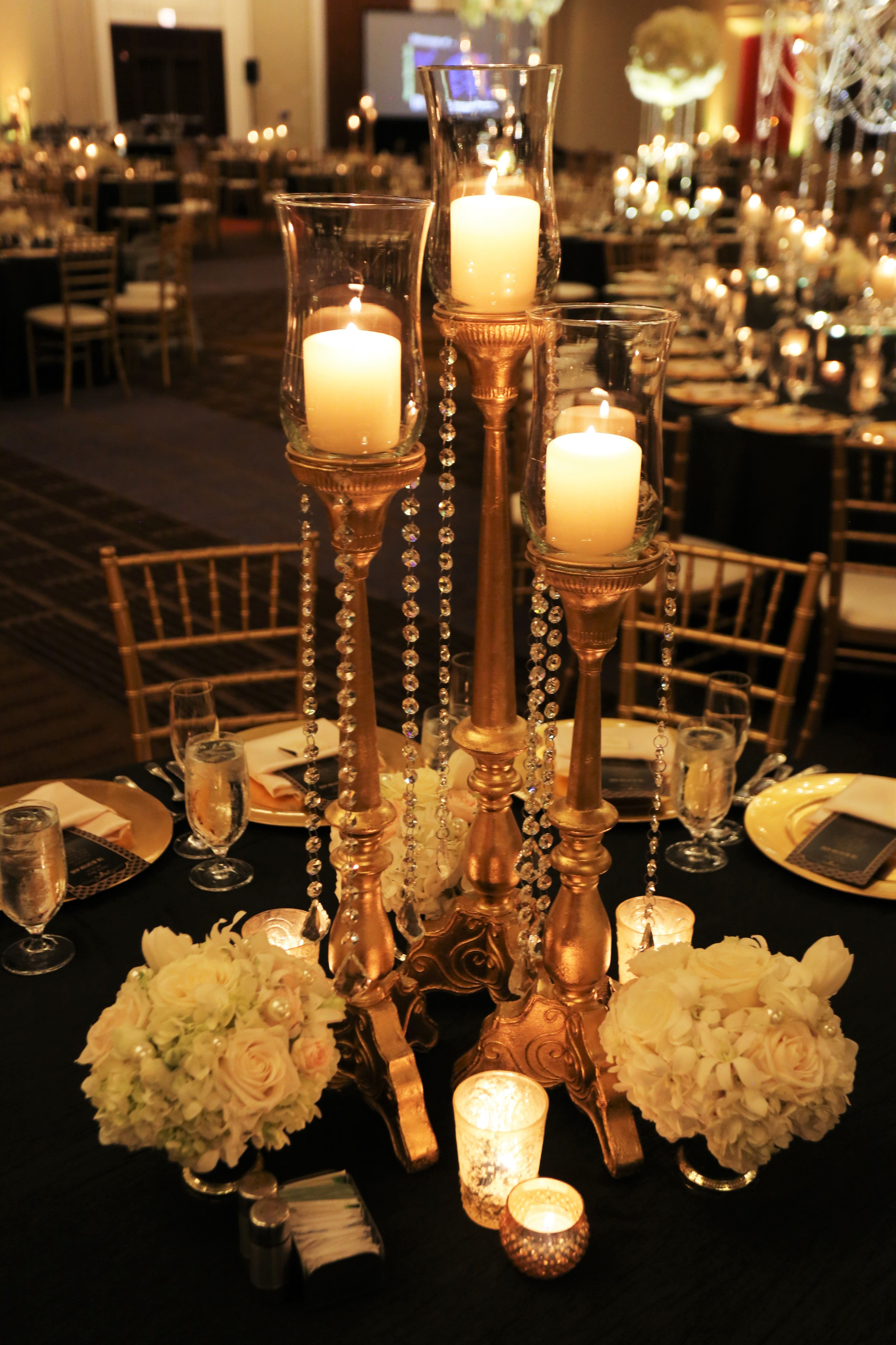 Gold metal candelabraus with a touch of ivory petite bouquets and